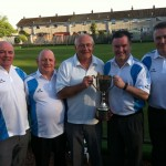 Michael Cavan and Charlie Kane present the Trophy to the winning team